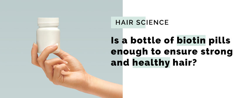 Is a bottle of biotin pills enough to ensure strong and healthy hair?